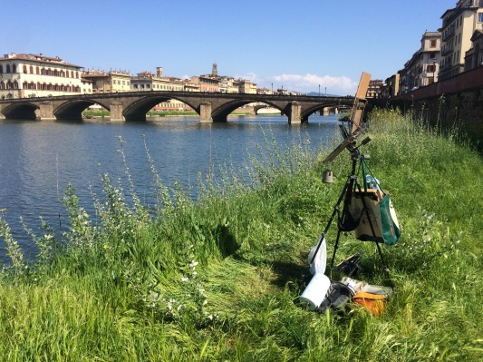 Plein air painting setup on the Arno River in Florence.